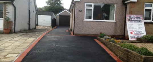 Picture Frame Tarmac with Red Border in Hodder Place Lancaster