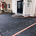 Picture frame tarmac with red paving and steps in Morecambe